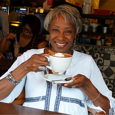Lisa J. Weiss drinking coffee in coffee shop